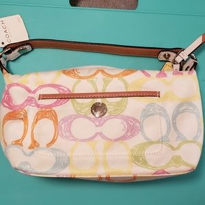 Cute multicolored Coach bag with leather accents